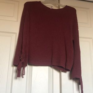 Sweater with ties on sleeves